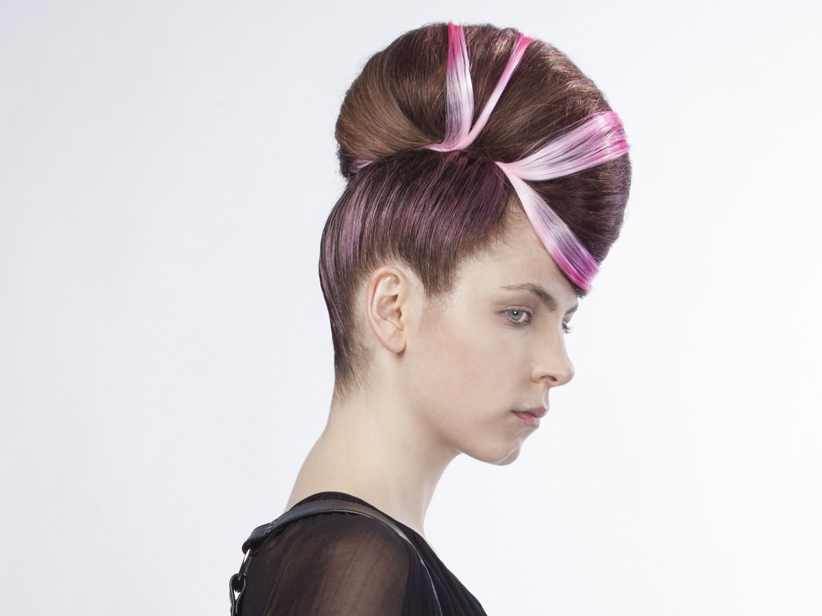 Futuristic updo with fuchsia hair sections