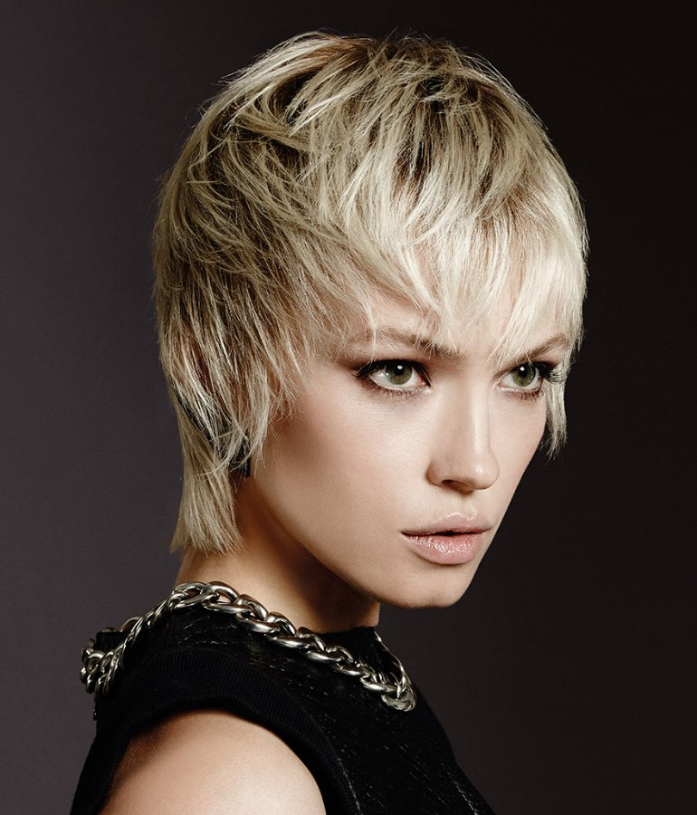 Short Blonde Hair That Falls Forward To Surround The Face