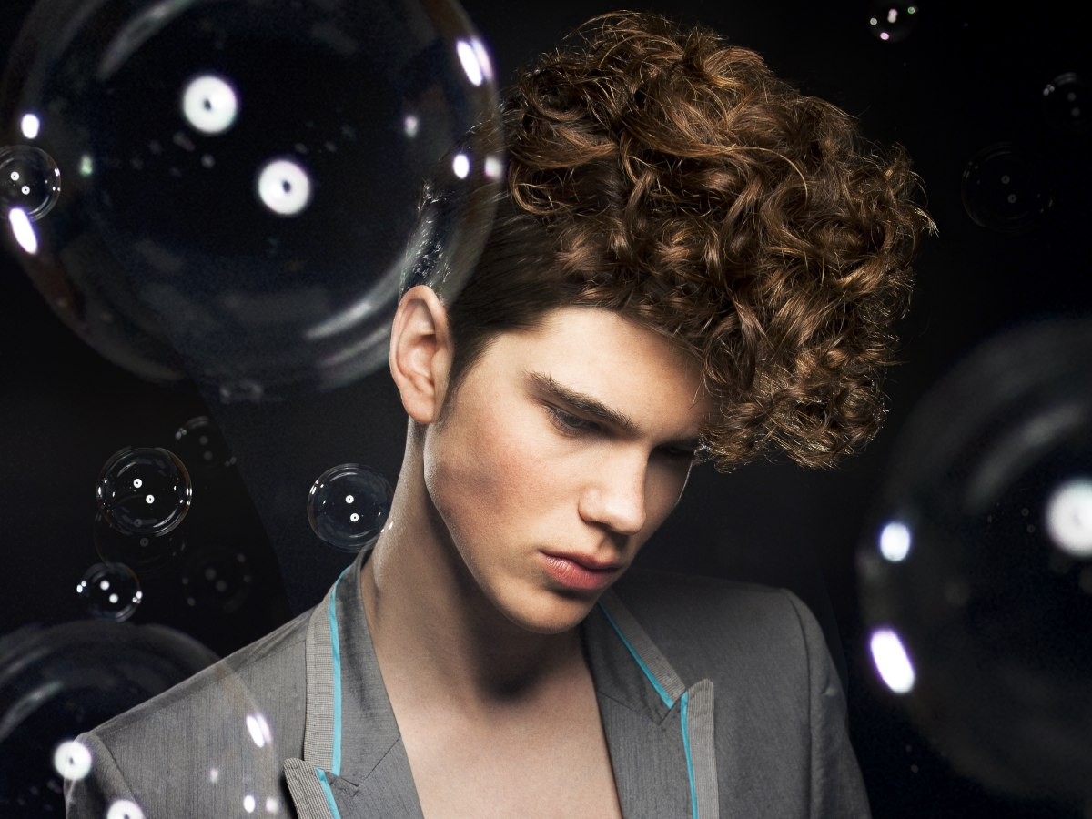 Curled Masculine Hair With A Quiff And Sideburns