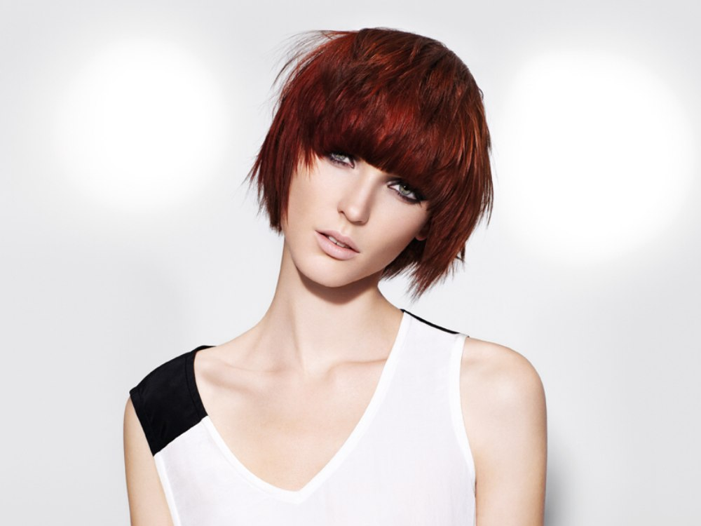 Short hairstyle with heavy bangs and wispy tapered sides