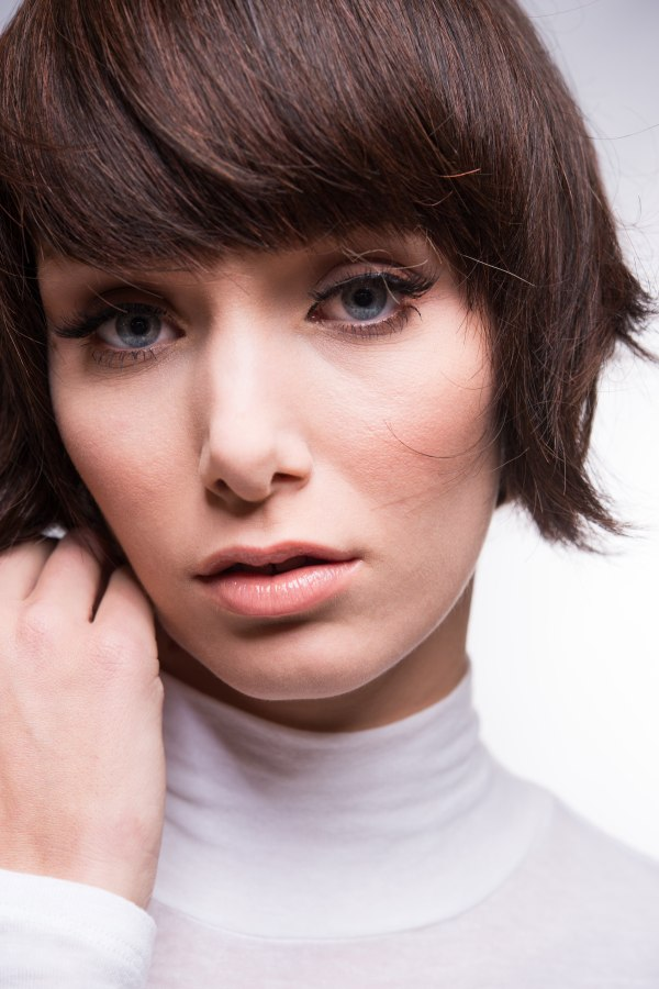 Feminine short hairstyle with wispy sides and a fringe