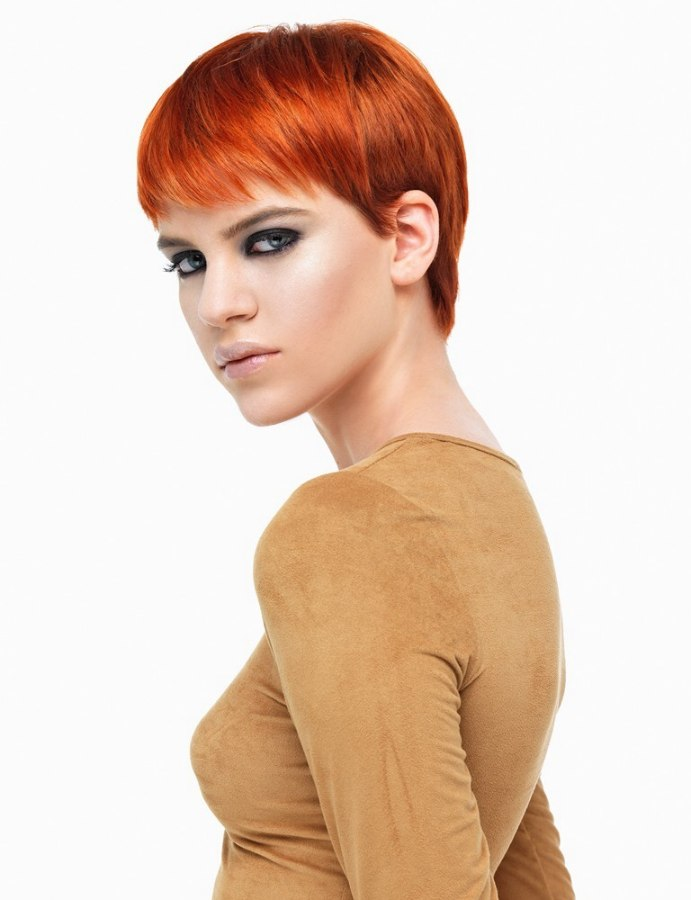 copper red hair in a classic pixie cut with a fringe. Black Bedroom Furniture Sets. Home Design Ideas