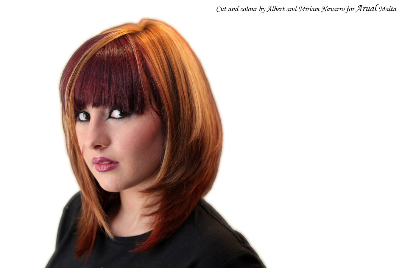 Long bob with a full fringe and hair color blocking