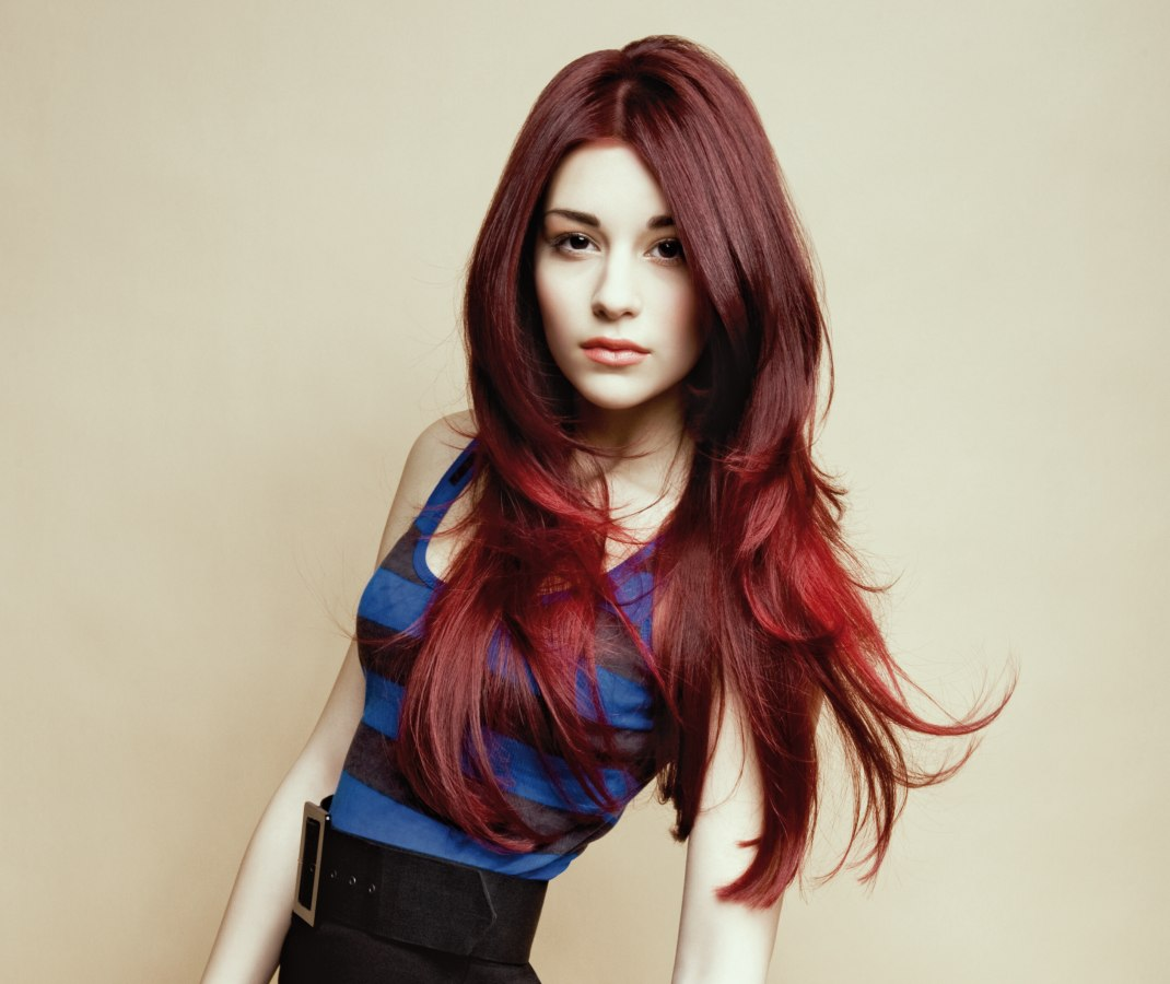 Extra long and layered hairstyle with a dark red haircolor