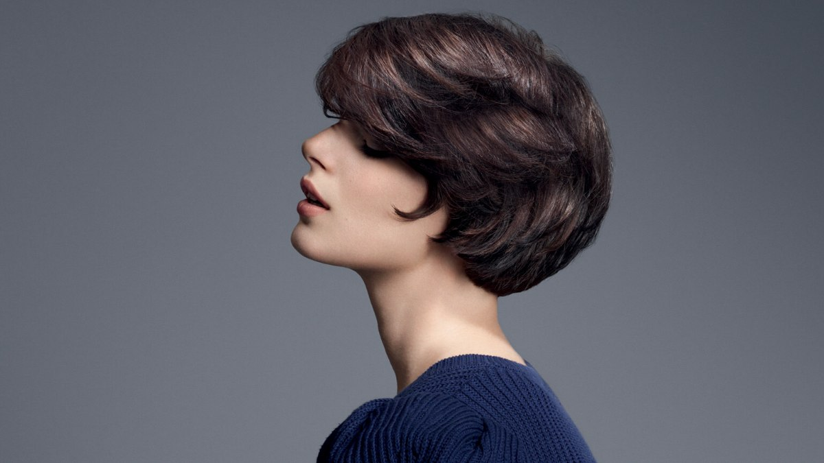 Short brunette hair with a round shape, long bangs and