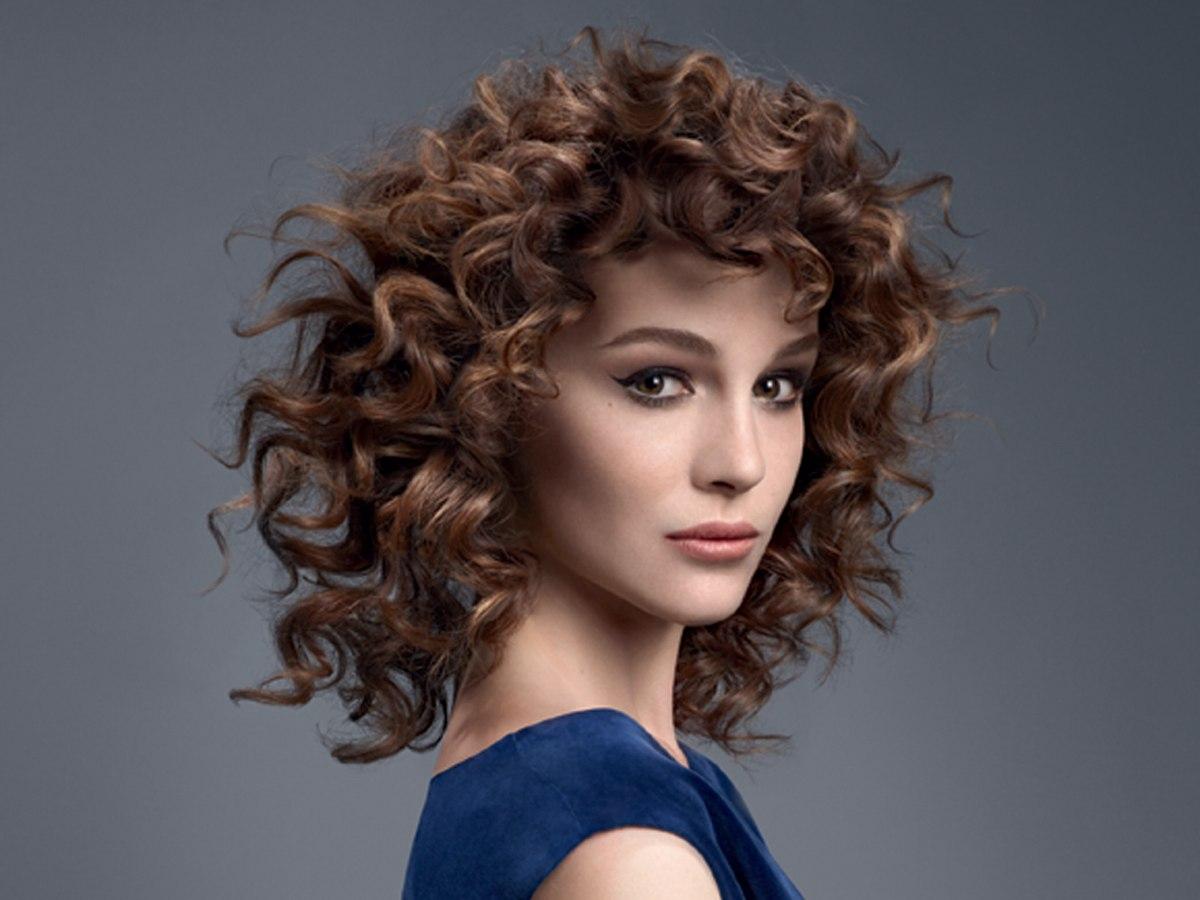 Medium Long Hair With Spiral Curls And Shorter Bangs