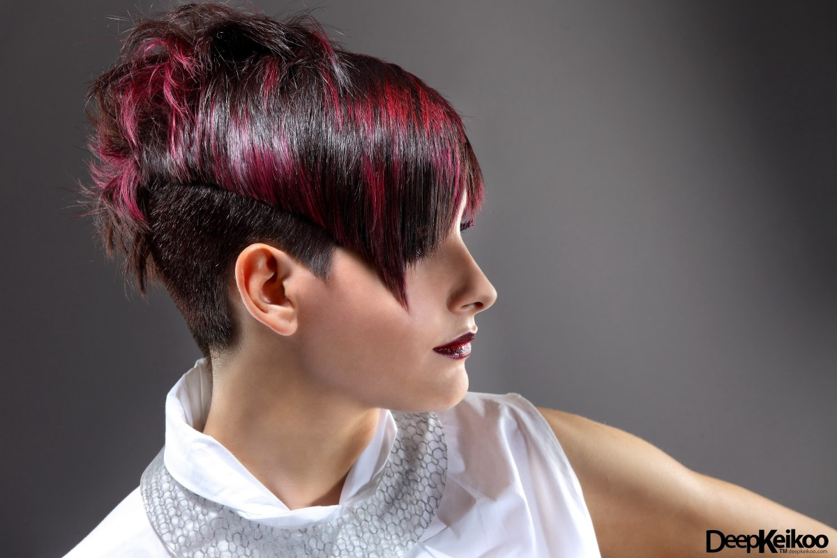 very short hairstyle with a back that is longer than the front