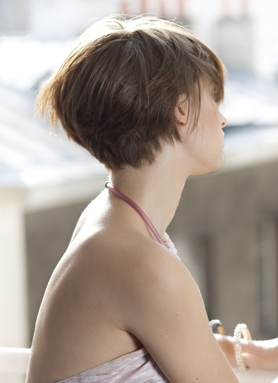 Side View Of A Short Haircut That Barely Covers The Ears