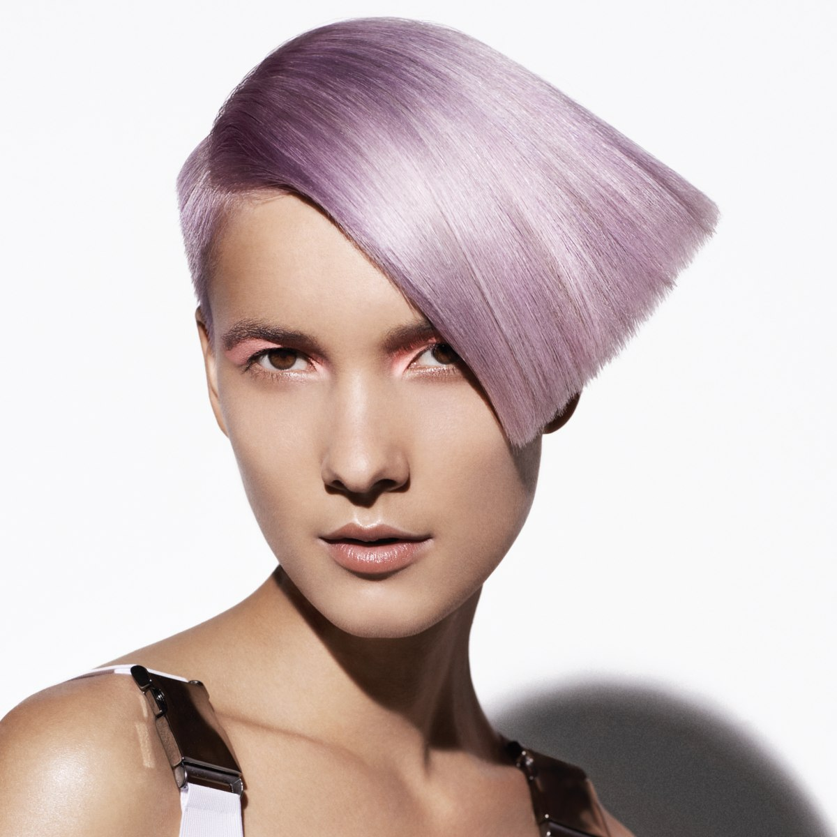 Short Wedge Haircut With A Shimmering Lavender Hair Color