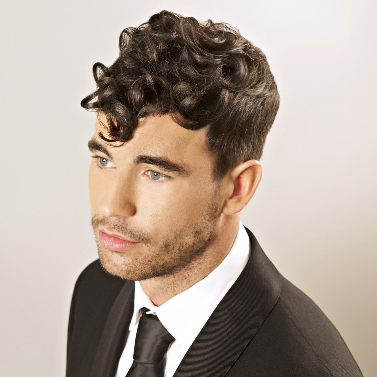 Vintage Inspired Mens Hairstyle With A Tuft Of Curls