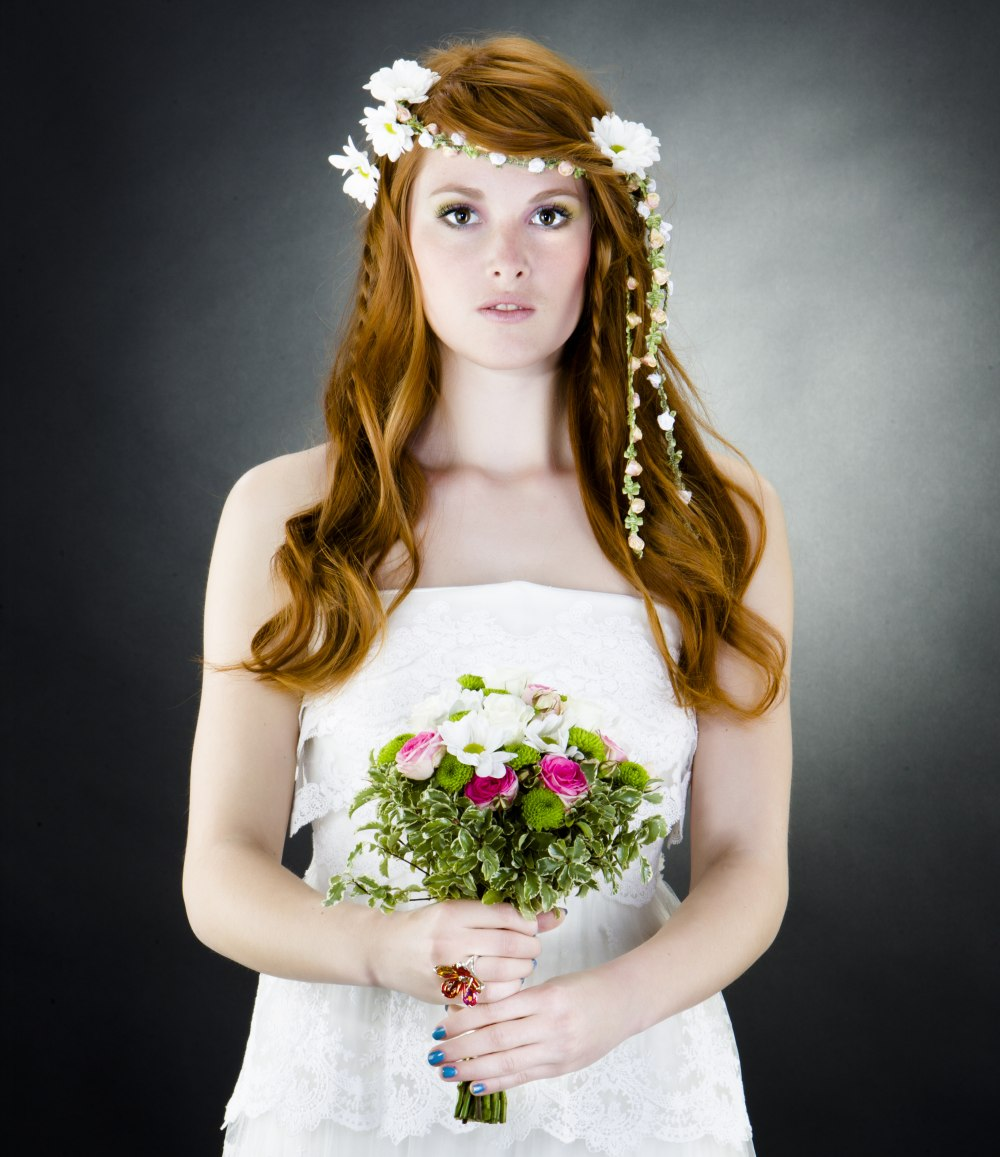 20 Wedding Hairstyles With Flowers: Wedding Hairstyle With Braids And A Band Of Flowers