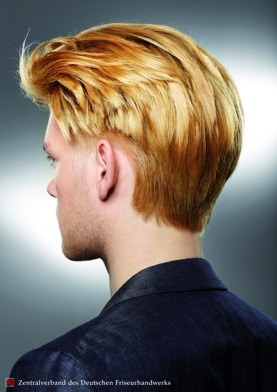 Men S Hairstyle With An Undercut Side Section And The