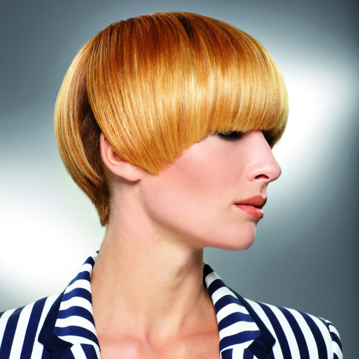 short bowl haircut with a fringe that throws a shadow over the eyes