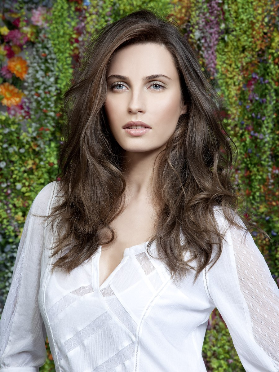 Voluminous Long Hair With Lift On The Roots And A Part On