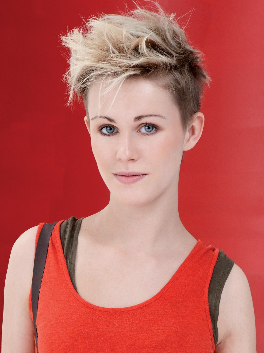 Very short haircut with windswept styling for fun and ...