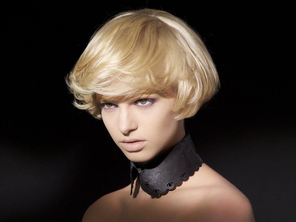 Sensational Ear Lobe Length Short Haircut With A Bit Of Layering Short Hairstyles For Black Women Fulllsitofus
