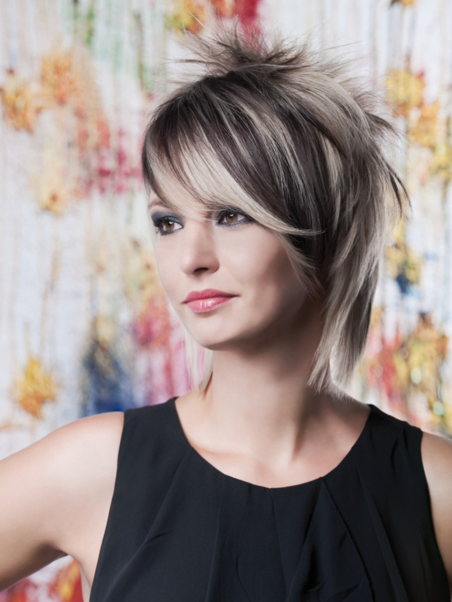 Modern Medium Length Haircut With Long Layers And Short Spikes