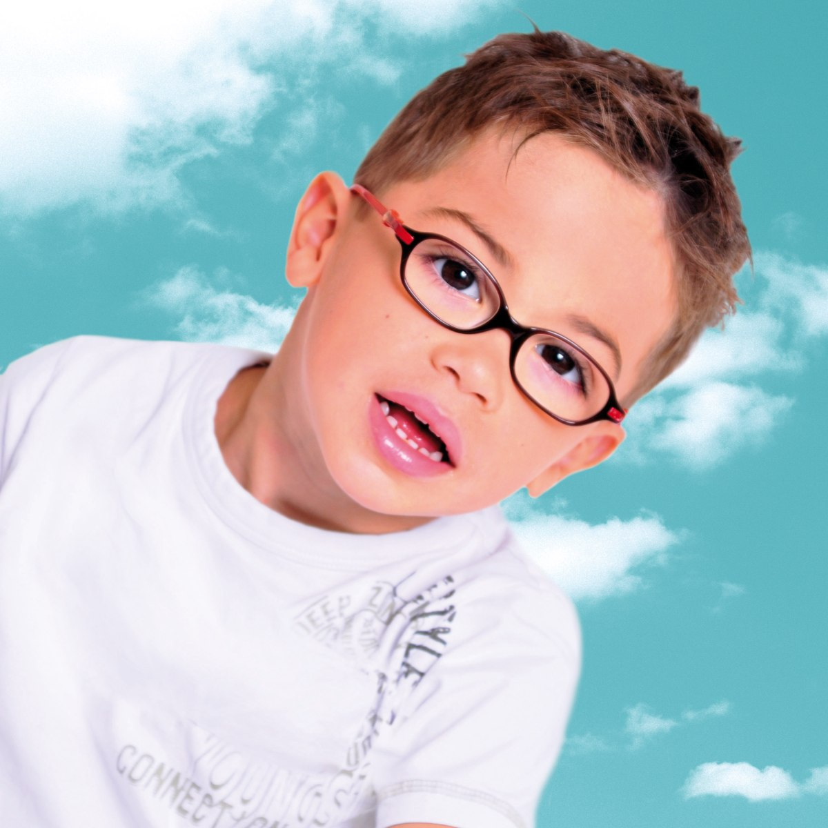Short And Sporty Haircut For A Little Boy Who Wears Glasses