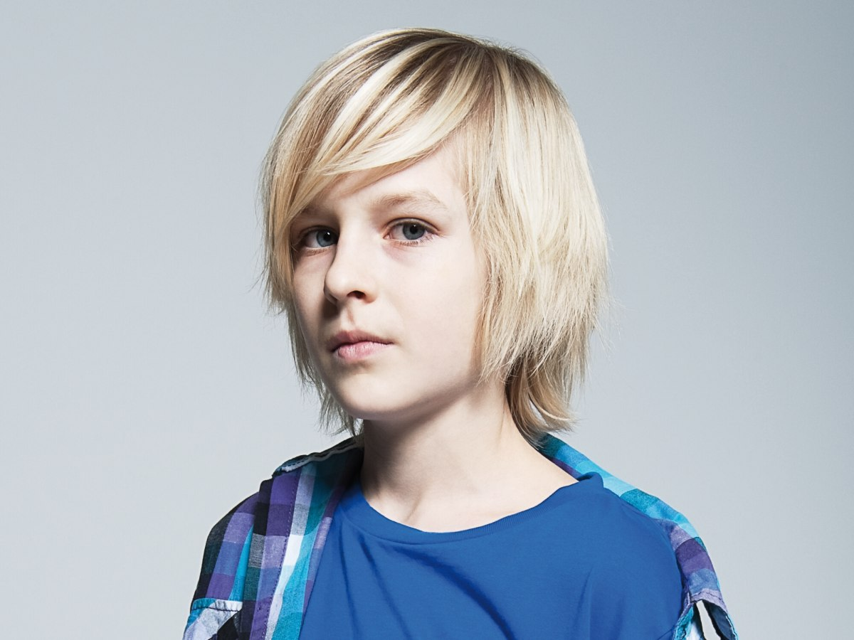Boy Hair Style: Medium Long Haircut For A Sporty Boy