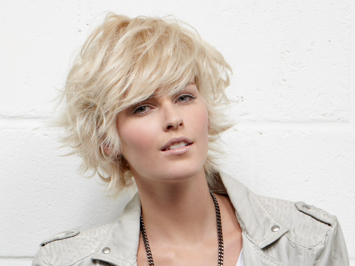 Feathery short haircut with the ends flipped up and out