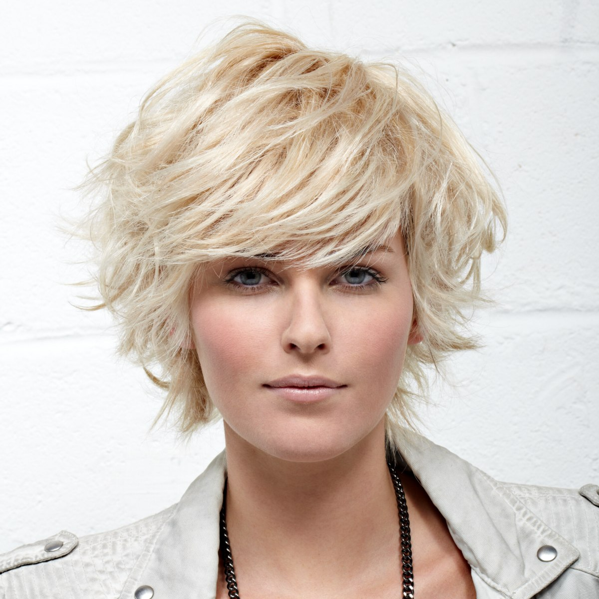 Medium Hairstyles: Feathery Short Haircut With The Ends Flipped Up And Out