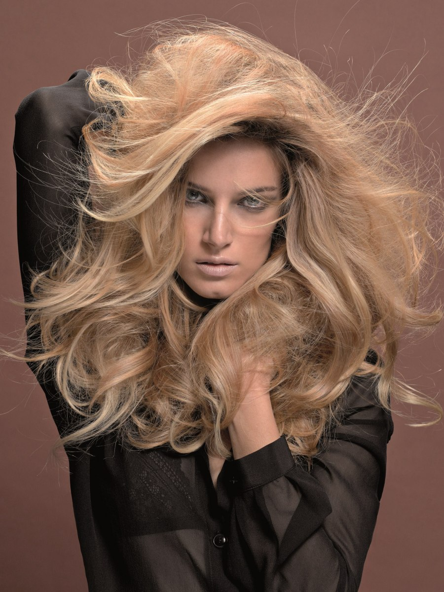 Big And Voluminous Blonde Hair With Long Layers