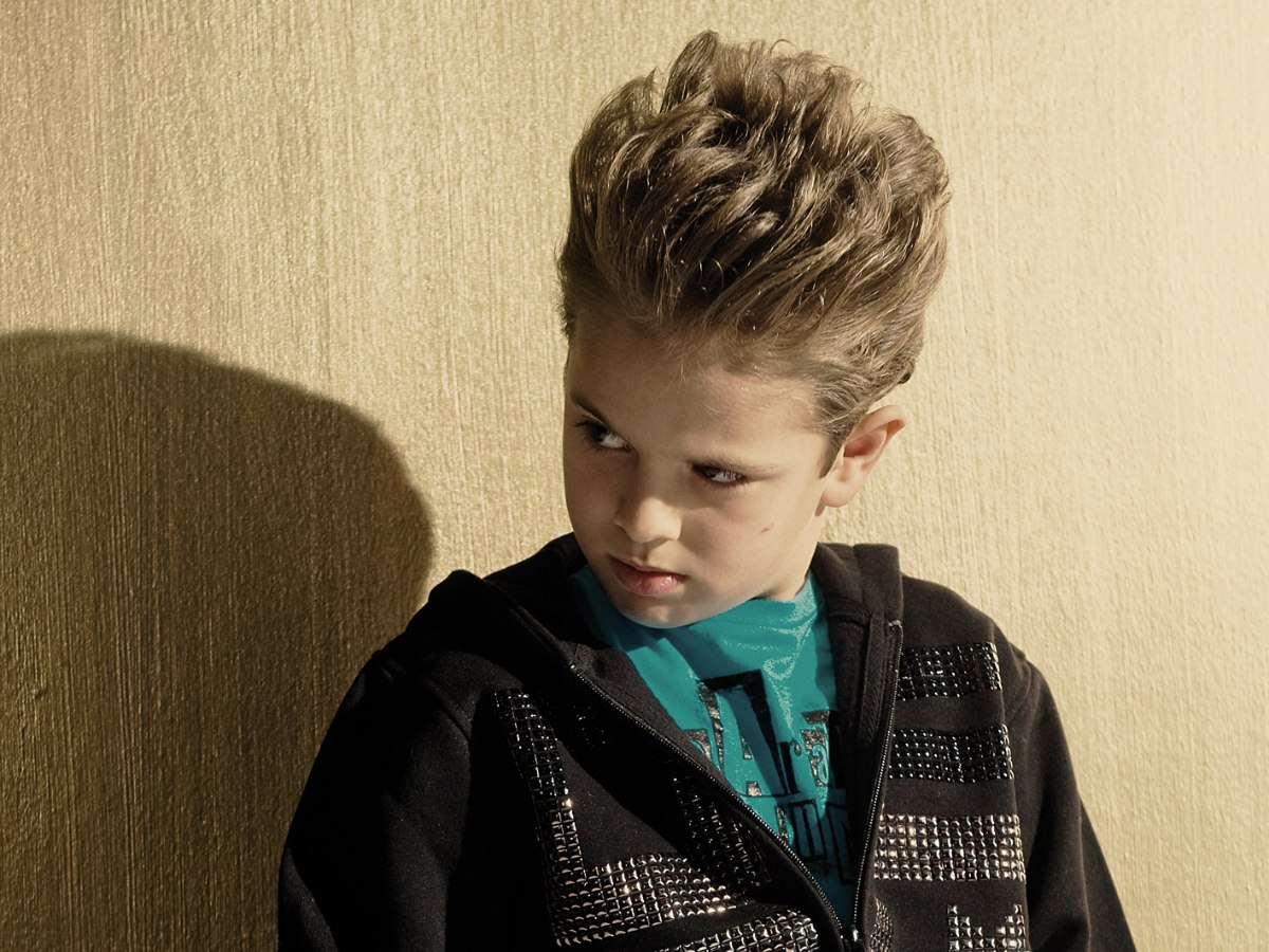 Boy with longer top hair which is lifted up and styled with gel