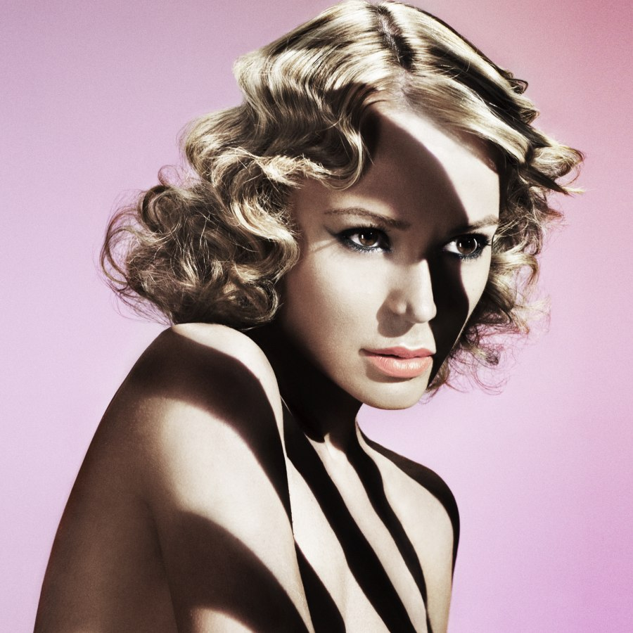 Medium Long 1940s Hairstyle With Waves And Curls