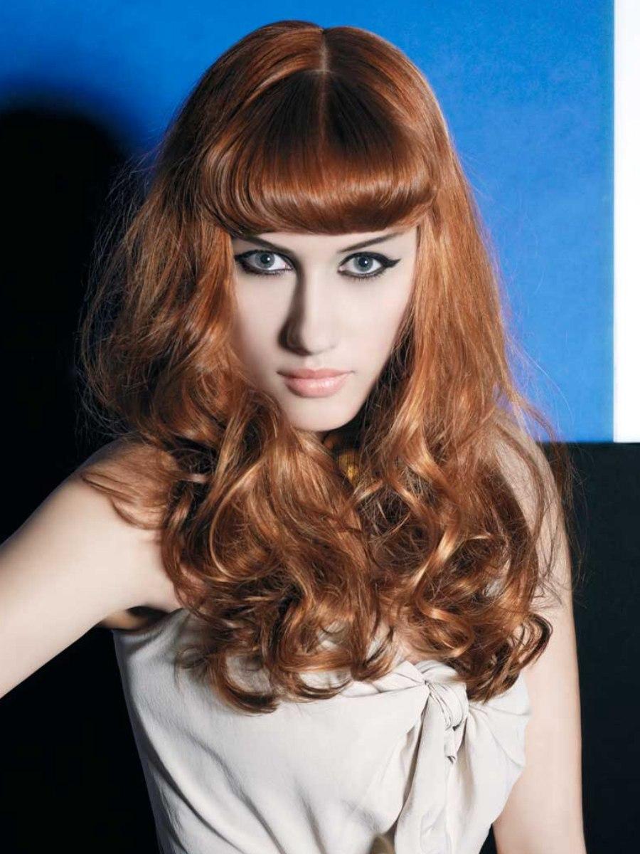 50s Style For Long Hair With The Fringe Styled Inward In A Rolling Curve