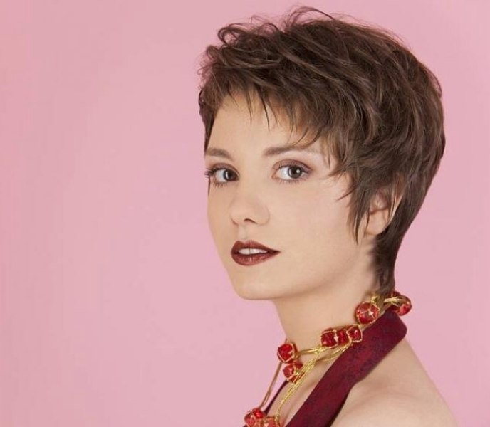 Elegant Short Haircut Lifted On The Roots For Chic Volume