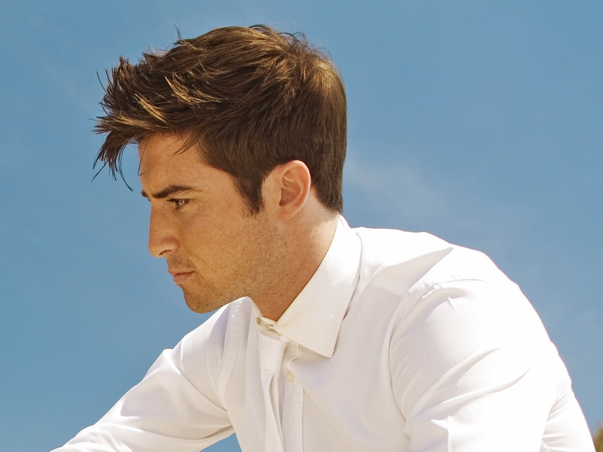 neat male haircut with a long fringe | side view