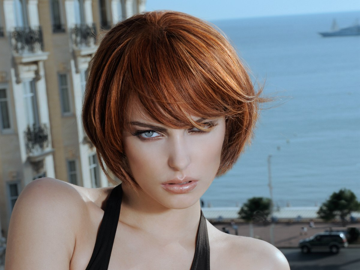Natural Short Haircut With A Sideward Fringe And Highlights