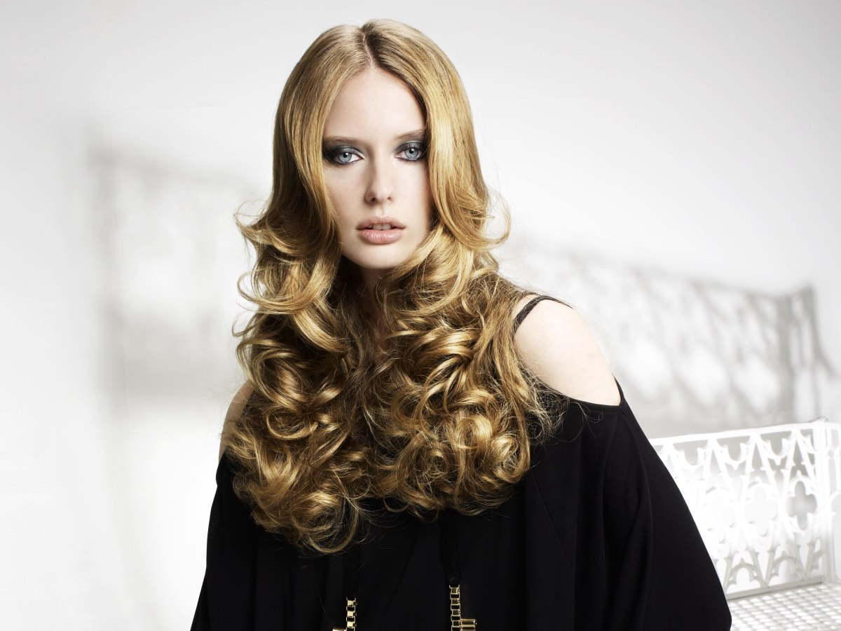 long hair with curls set using heated rollers