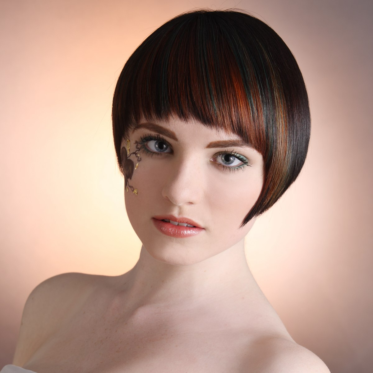 Smooth Short Hairstyle With A Fringe And Color Applied In