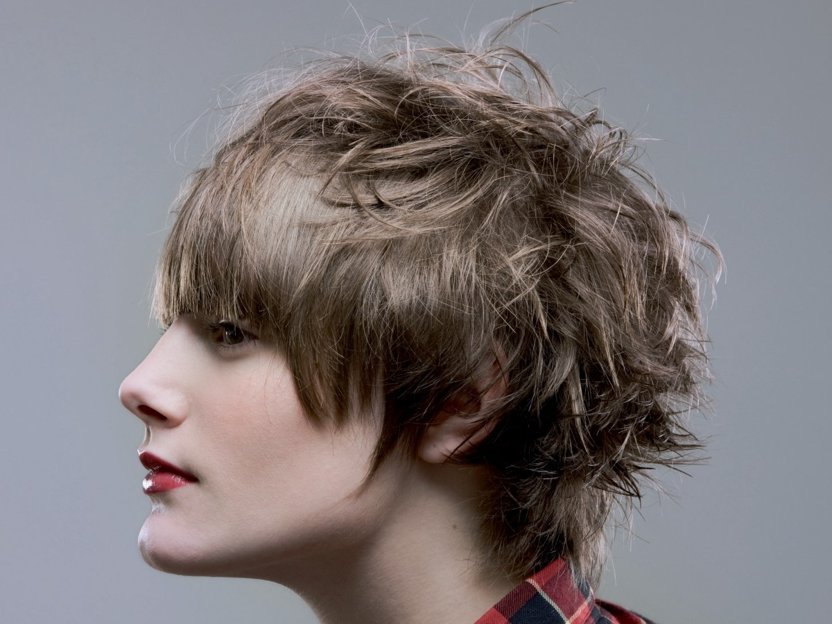 Short Boyish Haircut With A Graduated Back And A Low Fringe