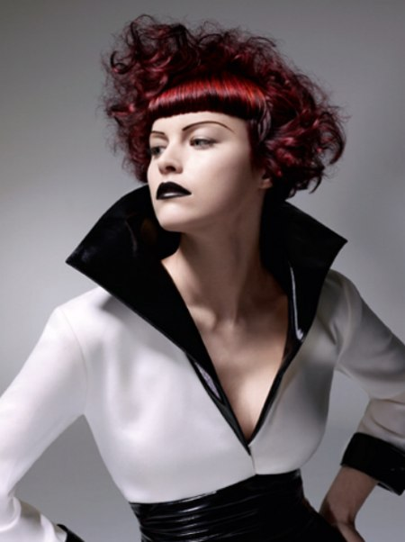 Red Hair With A Bevel Cut Rounded Fringe And Curls