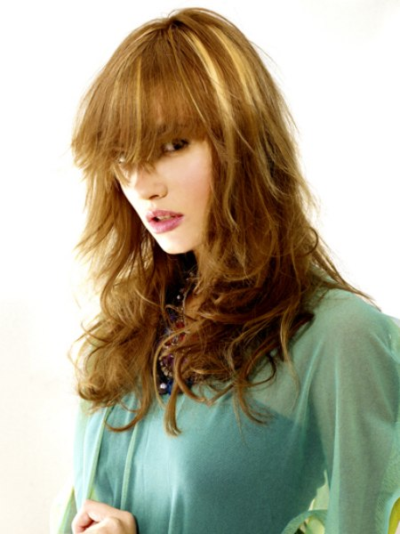 hairstyle with long bangs and wild tousled curls
