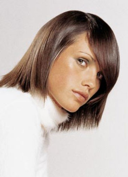 Fashionable Semi Bob Haircut With A Long Side Part That
