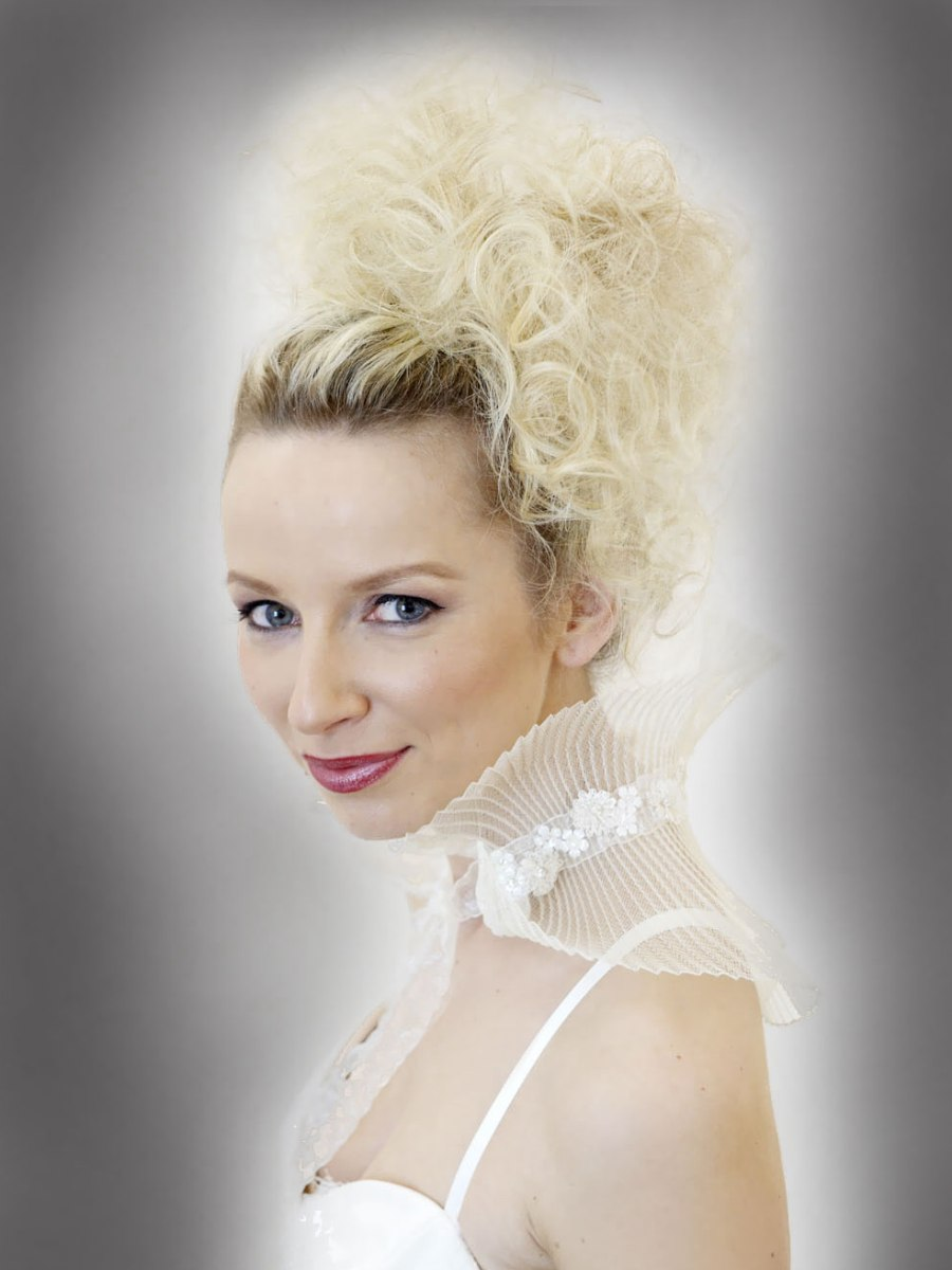 Wedding hair with curls pulled together to the side of the crown