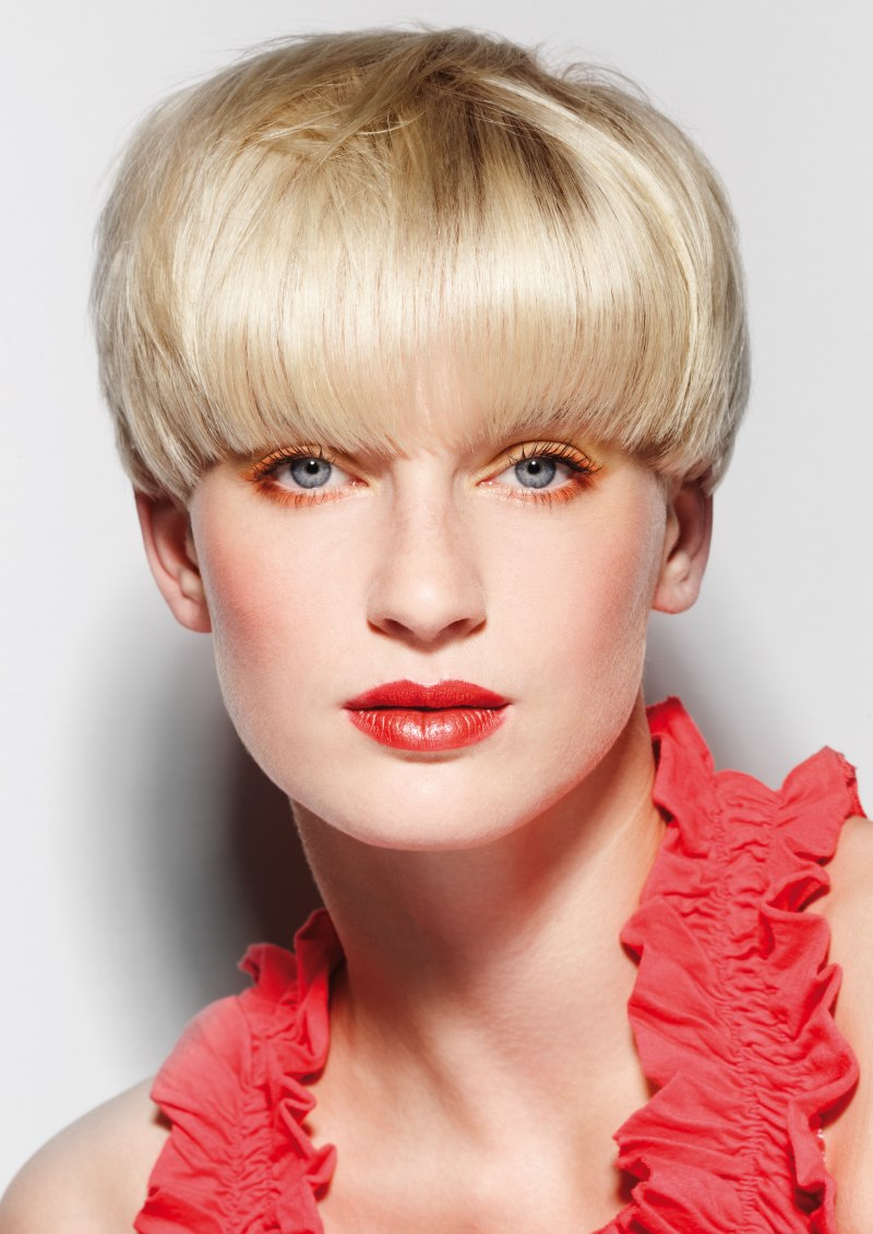 Short mushroom haircut that covers one quarter of the ear ...