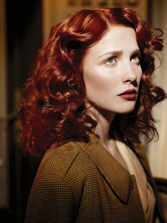 Post-war 40s vintage hairstyle for long red hair with curls and waves
