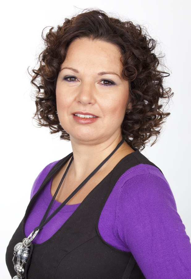 Hairstyle With Corkscrew Curls For Women Age 40 And Older