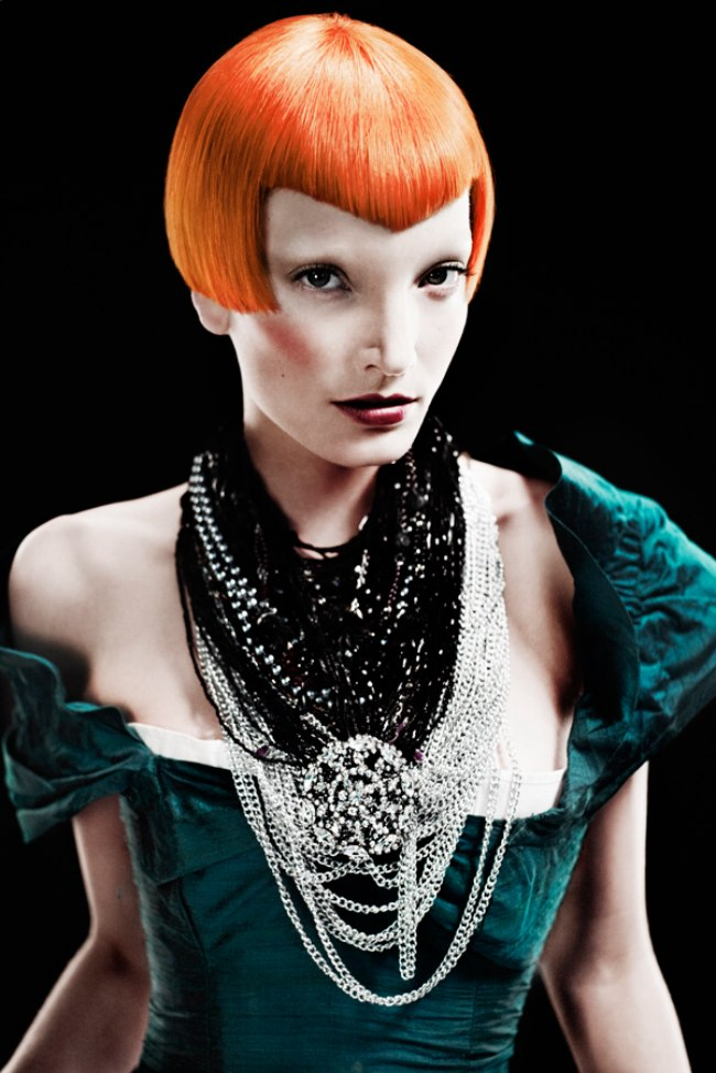 Mid Ear Length Blunt Cut Bob With A Pointed Fringe