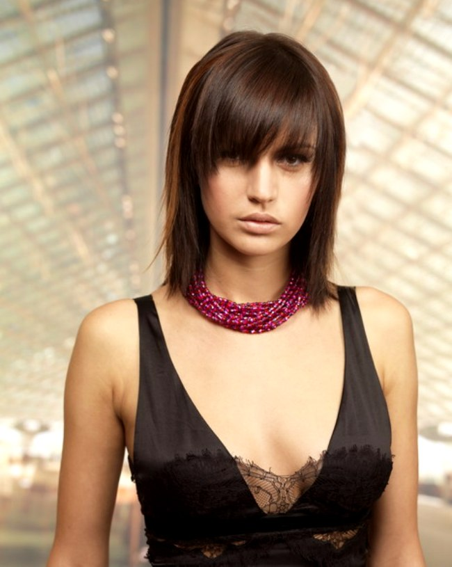 Shoulder length shag with a long textured fringe that almost hides ...