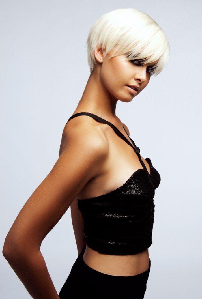 Short hair style with an eye-long fringe and a soft neckline