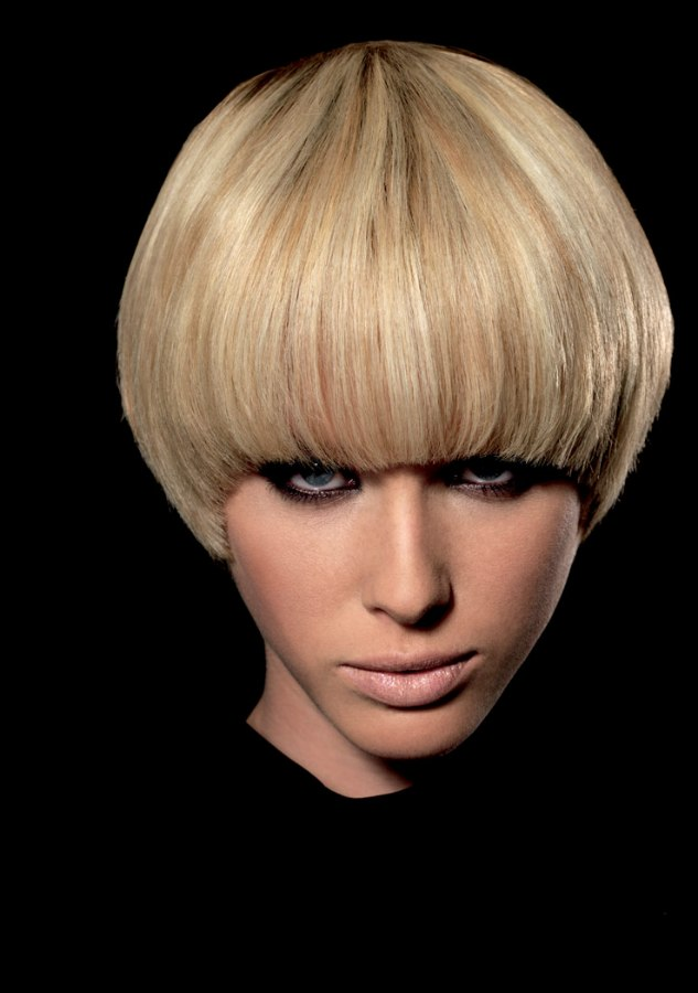 purdey cut short hairstyle with an elongated neckline