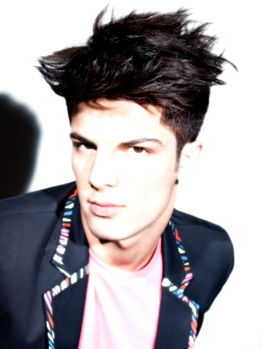 male punk hairstyle with short sides and a long spiked top