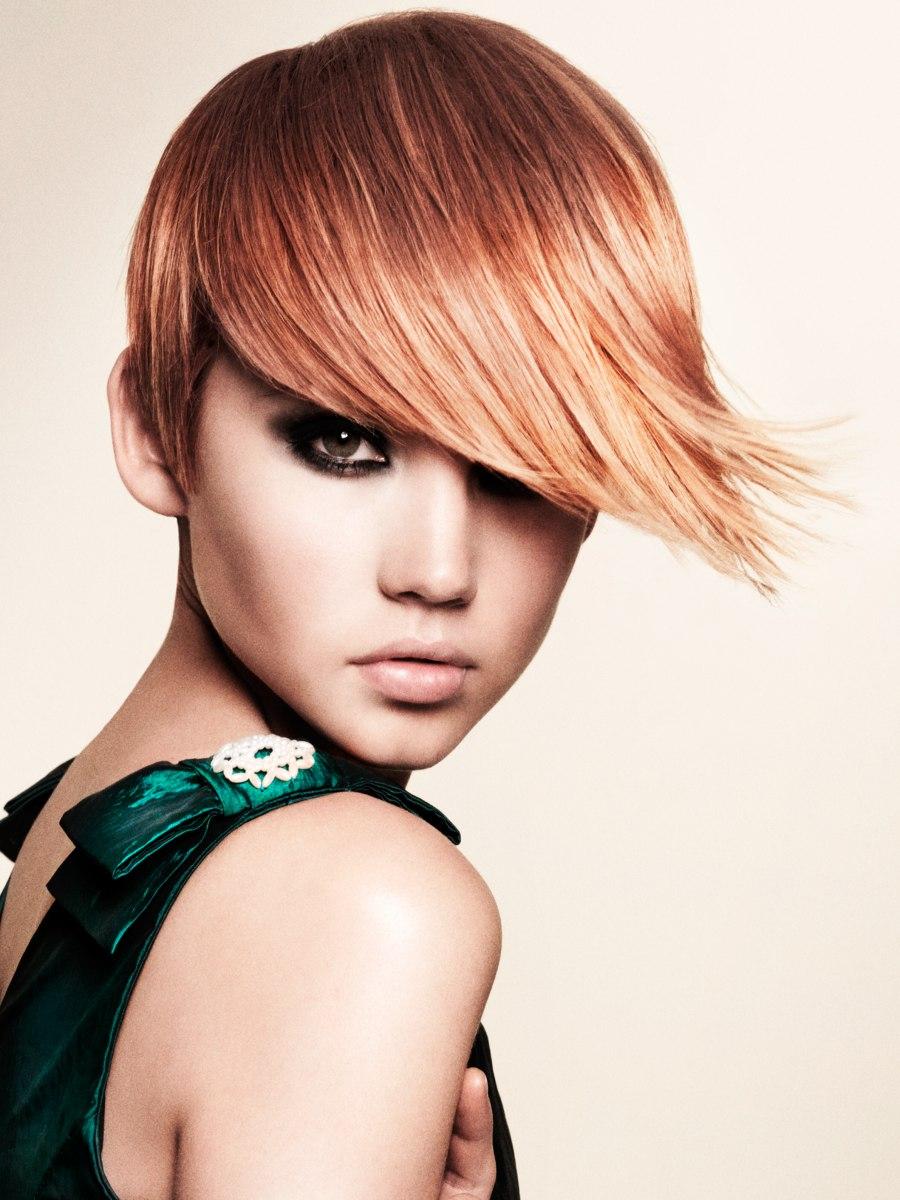 Short Reddish Blonde Hair With A Long Reversed Tear Drop