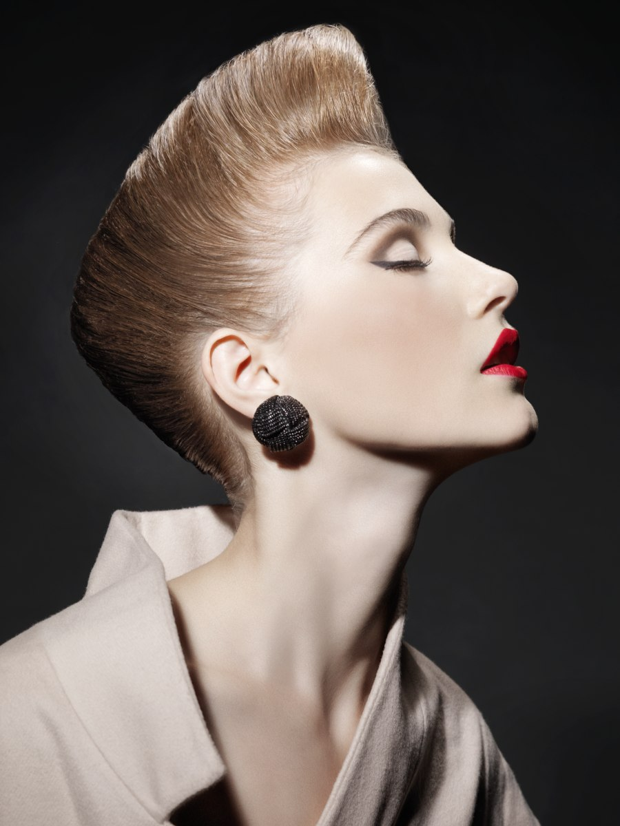 80s inspired short hairstyle with the hair slicked away