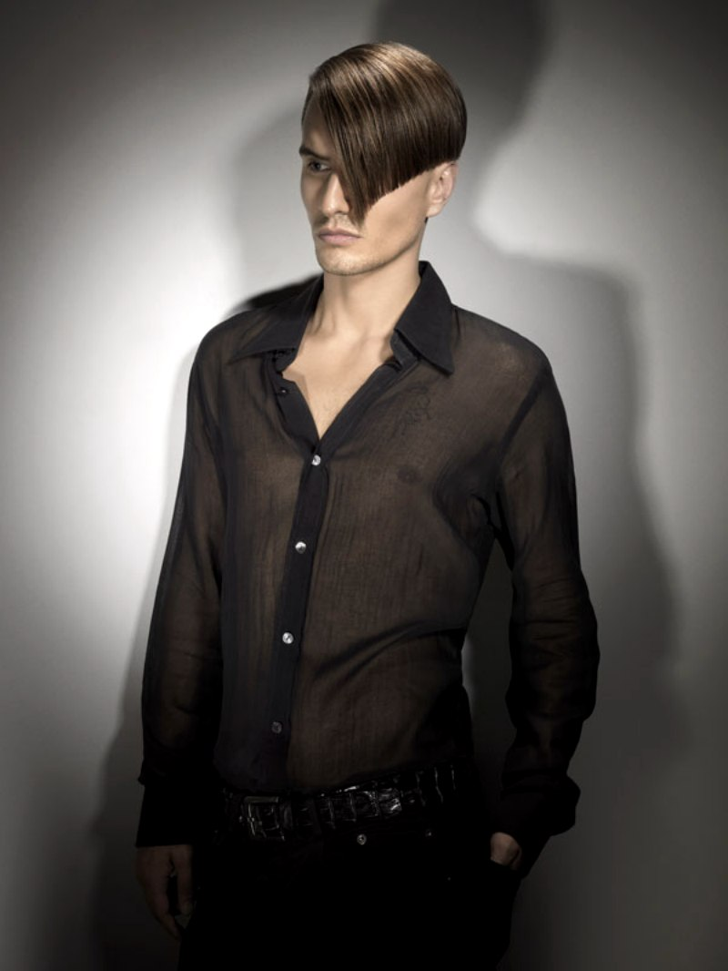 Sophisticated Men S Hairstyle With A Closely Clipped Nape